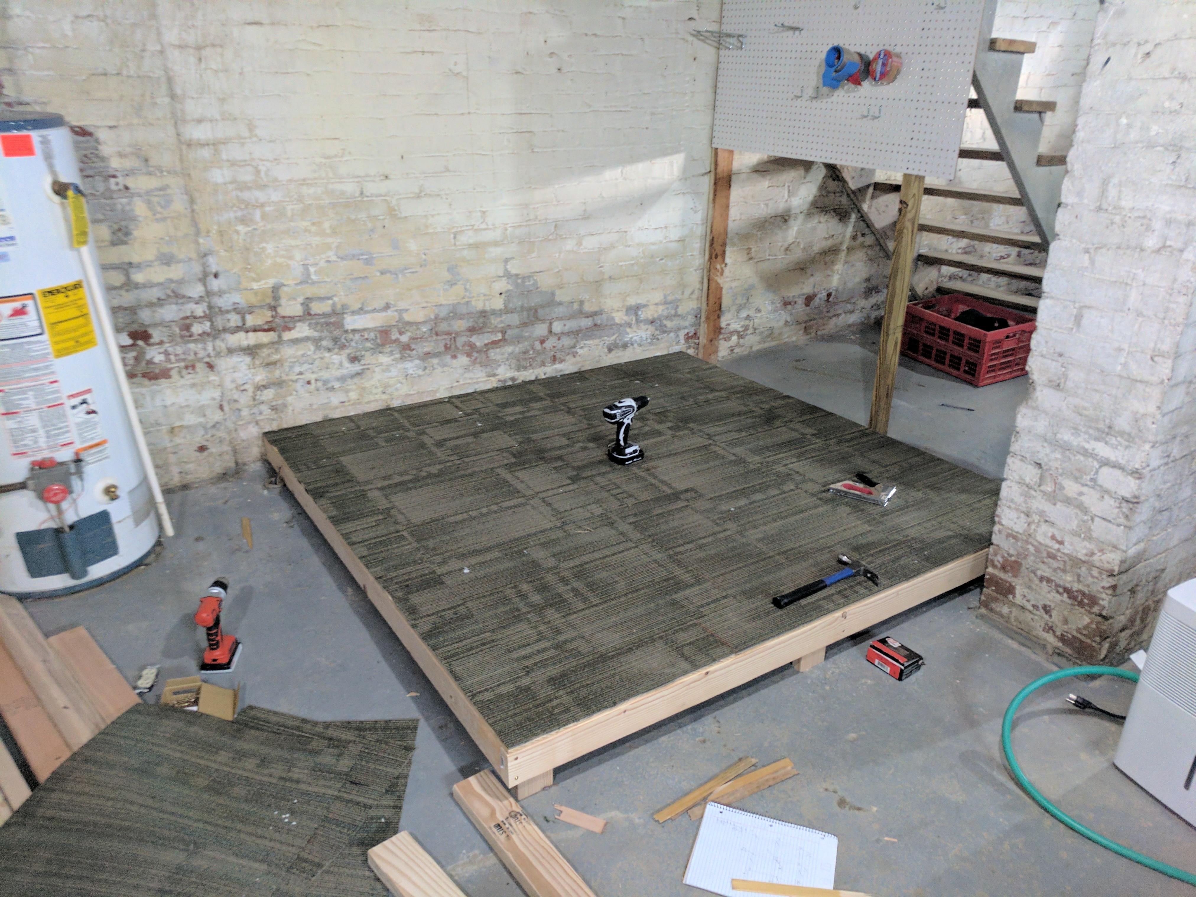 Raw plywood sucks, so we instead we get old office carpeting.